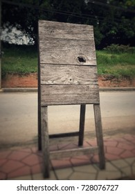 Empty aged vintage wood board for advertisement description in-front of retro shop