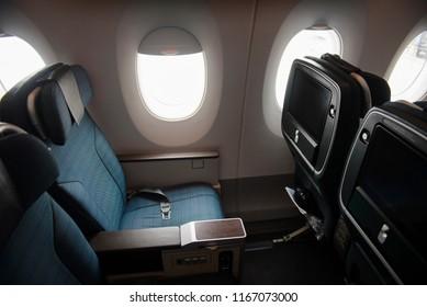 Empty aircraft premium economy class seats and windows