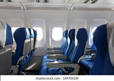 Empty aircraft seats and windows.