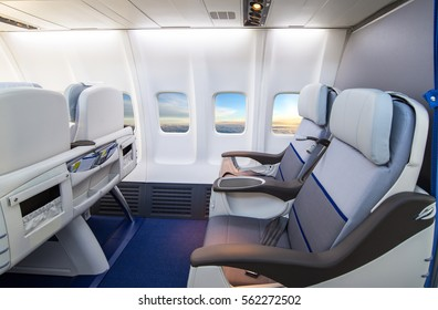 Empty aircraft seats and windows.