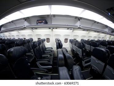 Empty airplane interior sideways. Shot with fisheye lens, same noise