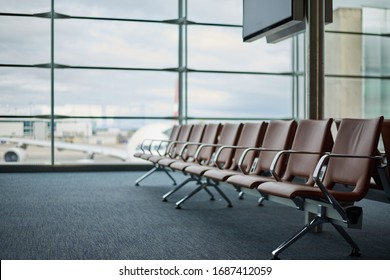 Empty airport with blurred plane and cloudy tragik sky on a background