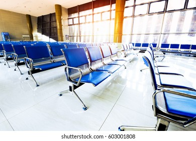 Empty airport terminal waiting area with chairs in Shanghai Hongqiao airport.