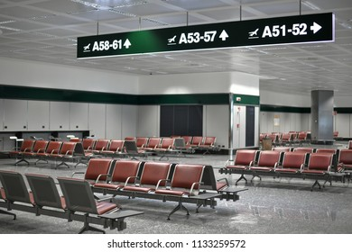 Empty airport waiting room with indications to departure gates