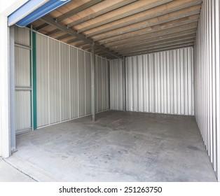 Empty aluminum garage with roller door