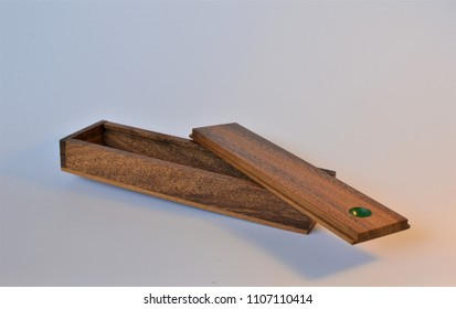 Empty antique wooden box with a sliding lid on an isolated background (Mikado).