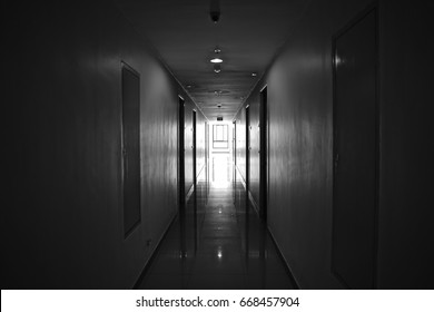 Empty apartment hallway in black and white.