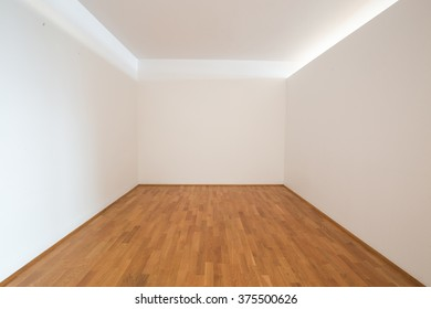 Empty apartment interior, hardwood floor with white painted walls