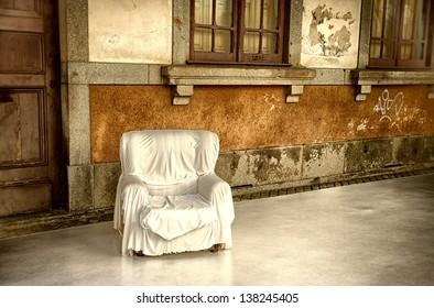 Empty armchair outside in the street at siesta time - Braga, Portugal.