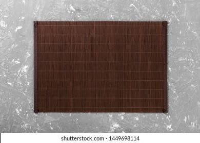 Empty Asian Food Background. Dank Bamboo mat on wooden background top view with copy space flat lay.