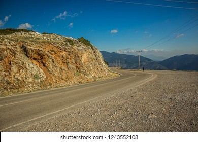 empty asphalt car road in high mountain nature landmark environment  with lonely traveler far from shot point