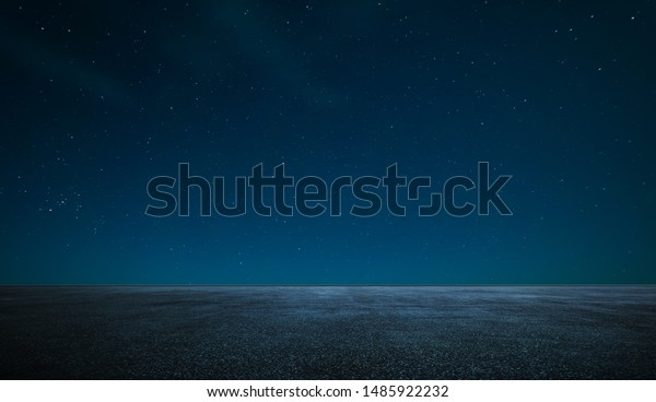 Empty asphalt floor with night sky .