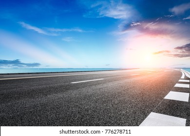 empty asphalt highway and blue sea nature landscape at sunset - Shutterstock ID 776278711
