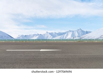 empty asphalt highway and snow mountain background