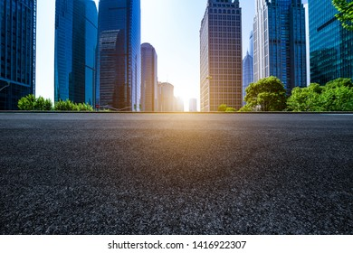 Empty asphalt pavement in the background of modern urban architecture in lujiazui, Shanghai
