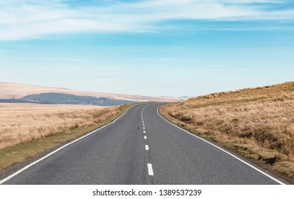 Empty asphalt road across vast hilly landscape of Brecon Beacons in Wales, UK