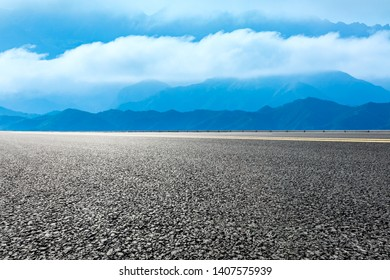 Empty asphalt road and beautiful mountains with clouds sea nature landscape