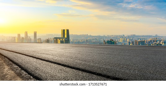 Empty asphalt road and Chongqing city skyline and buildings at sunset,China.