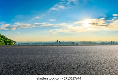 Empty asphalt road and Chongqing city skyline and buildings at sunset,China. - Shutterstock ID 1713527674