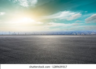 Empty asphalt road and city skyline with buildings in Shanghai,high angle view