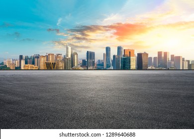Empty asphalt road and city skyline with buildings in Hangzhou,high angle view