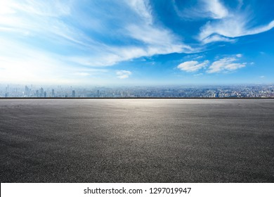 Empty asphalt road and city skyline in Shanghai,high angle view