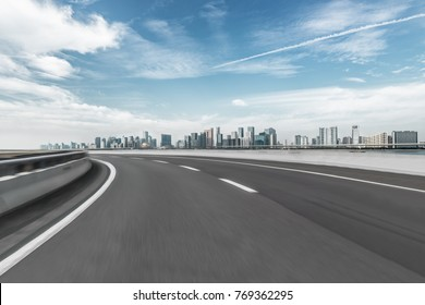 empty asphalt road with city skyline background in china.