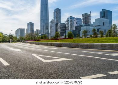 empty asphalt road front of modern buildings