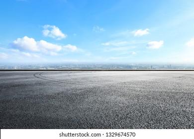 Empty asphalt road ground over modern city