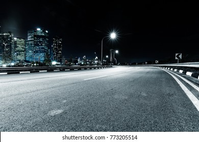 empty asphalt road in midtown of kuala lumpur at night