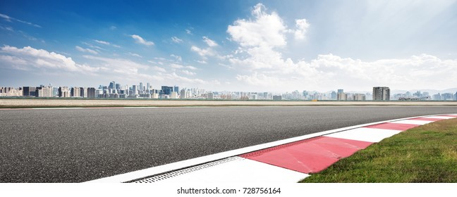empty asphalt road in modern circuit and cityscape of shaoxing in blue cloud sky