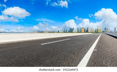 Empty asphalt road and modern city skyline with buildings in Hangzhou.