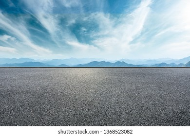 Empty asphalt road and mountains with beautiful clouds landscape