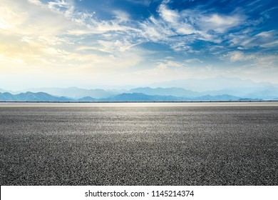 Empty asphalt road and mountains natural scenery at sunrise