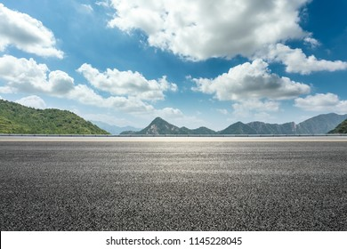 Empty asphalt road and mountains natural scenery under the blue sky