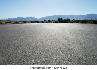 empty asphalt road near mountains in new zealand