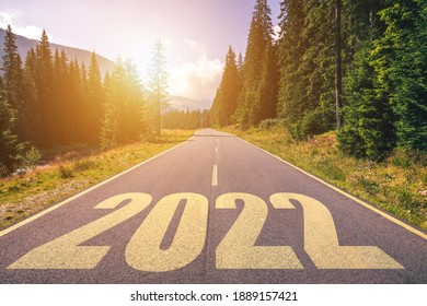 Empty asphalt road and New year 2022 concept. Driving on an empty road in the mountains to upcoming 2022. Concept for success and passing time.