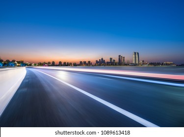 empty asphalt road with panoramic city skyline in shanghai