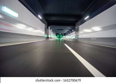 empty asphalt road in tunnel