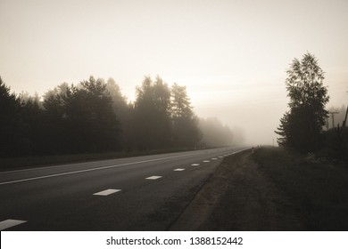 empty asphalt road with white lines painted in misty july morning - vintage retro look