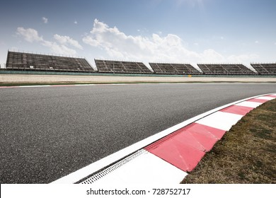 empty asphalt road in zhejiang circuit in shaoxing in blue cloud sky