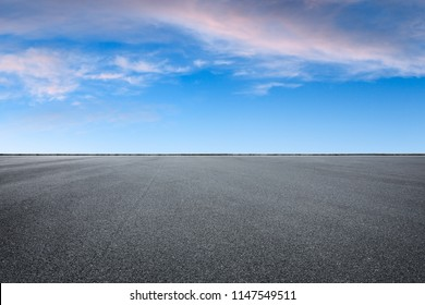Empty asphalt square and beautiful colorful sky clouds at sunrise