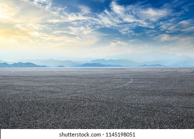 Empty asphalt square and mountain scenery at sunrise
