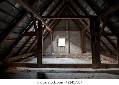 Empty attic roof space with window during reconstruction