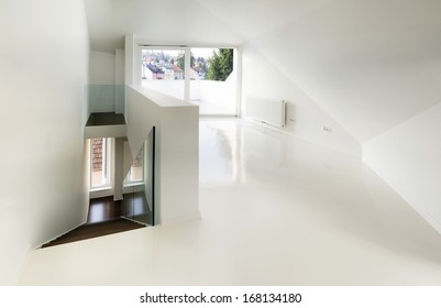 empty attic room with white epoxy flooring