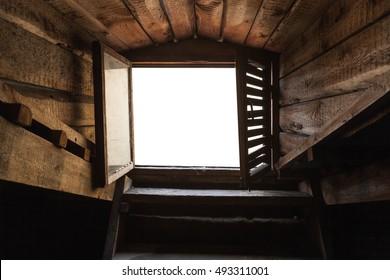 Empty attic window with white background in old grunge wooden interior