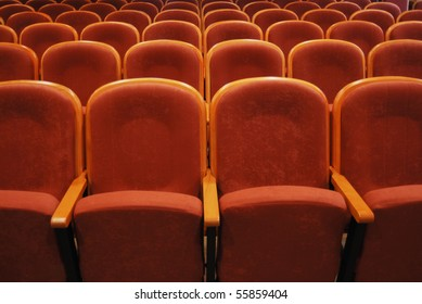empty auditorium with red chairs, theatre or conference hall