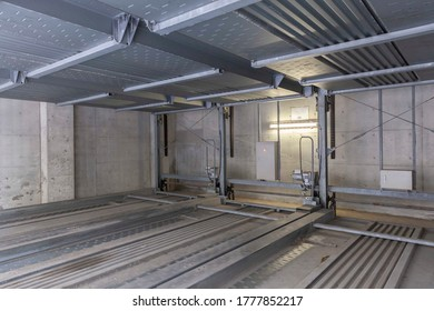 Empty automatic car Parking Lift The basement in the office building