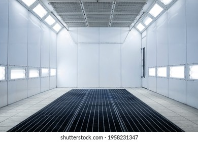 Empty automobile painting chamber or workshop interior.