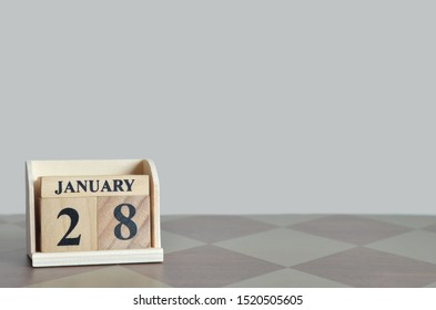 Empty Background with number cube on the table, January 28.